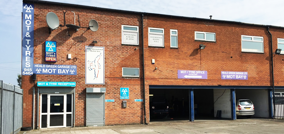 Front of our garage workshop in Heald Green in Manchester - Tyres and MOT Wythenshawe